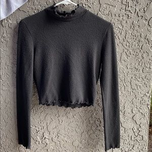 Black cropped turtleneck sweater w/ scalloped neck